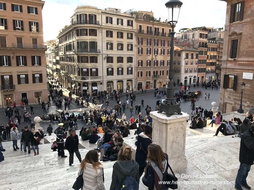 Lots of people sitting on spanish steps