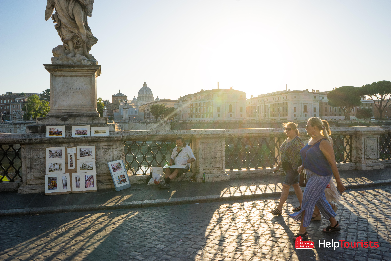 ROME_Street_artist_Ponte_Sant'Angelo_sunset_St. Peter's Basilica_l